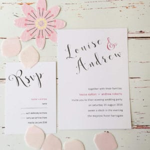 A trendy modern pink wedding invitation