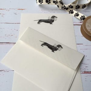 Writing paper with mataching envelope with a Dachshund illustration