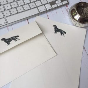 Writing paper with a Retriever illustration