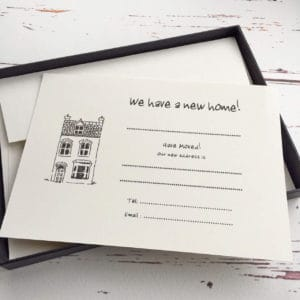 Blank change of address cards with a town house illustration