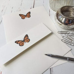 Writing paper with an Orange Butterfly illustration