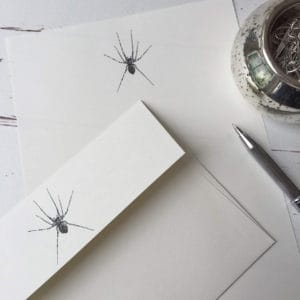 Writing paper with a Spider illustration