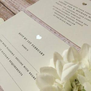 A silver heart modern wedding invitation