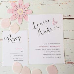 A trendy modern pink wedding invitation