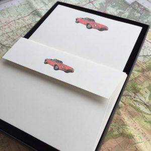 Writing paper with an E type Jaguar illustration