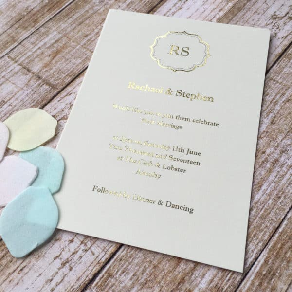 A gold foil wedding invitation