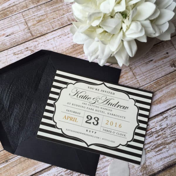 A black and white postcard style wedding invitation