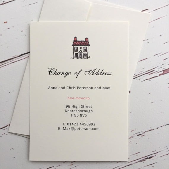 A change of address card with a red roof illustration
